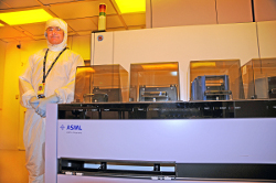 CNF staff alongside the ASML tool in the cleanroom